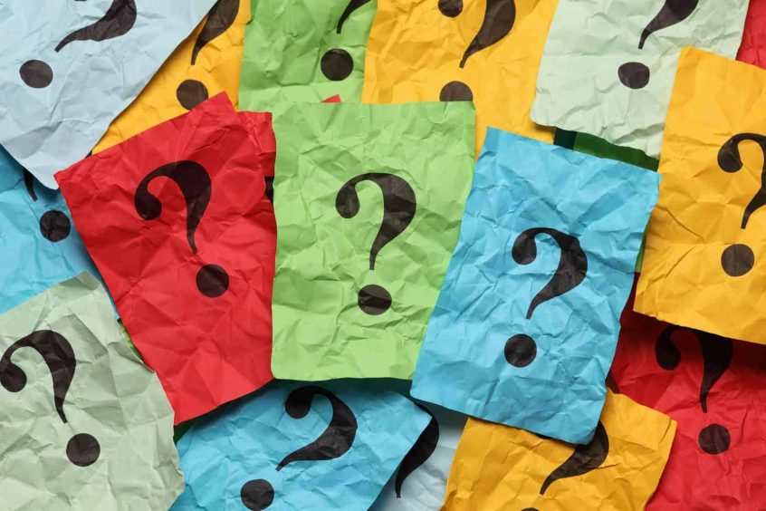 Colorful paper with back question marks