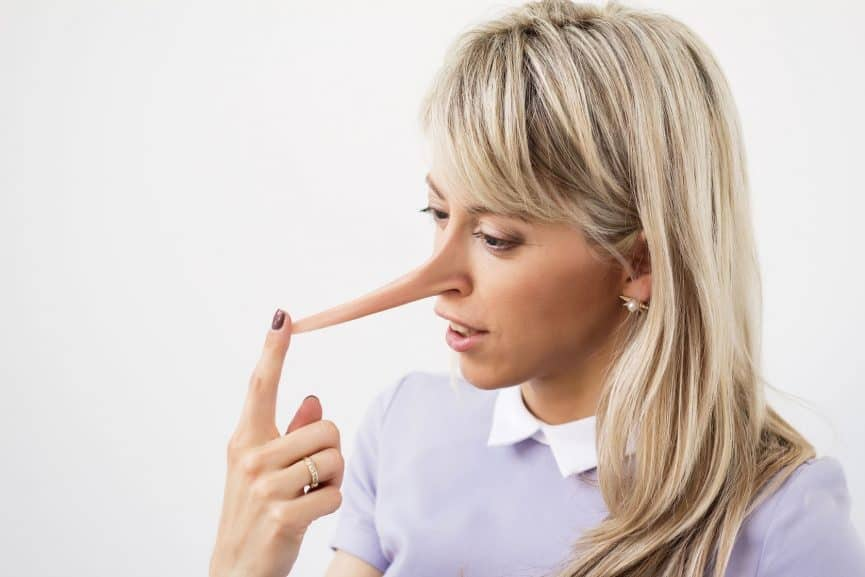 Woman with long nose implying she's lying
