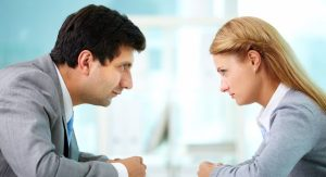 Photo of two people staring at one another for Conflict Resolution Skills workshop