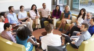 Photo of office staff meeting together for Respectful Workplaces workshop