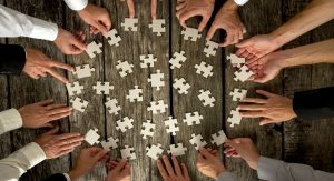 Image of putting puzzle together, Team Development, ACHIEVE