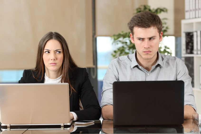 Image of two angry people working on computers, ACHIEVE Leadership Training